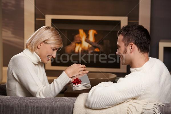 Pár ajándék otthon fiatal romantikus ül Stock fotó © nyul