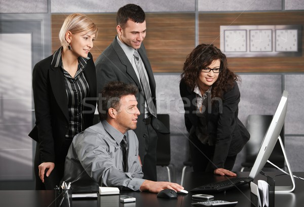 Business team looking at screen Stock photo © nyul