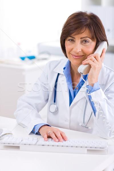 Doctor calling on phone Stock photo © nyul