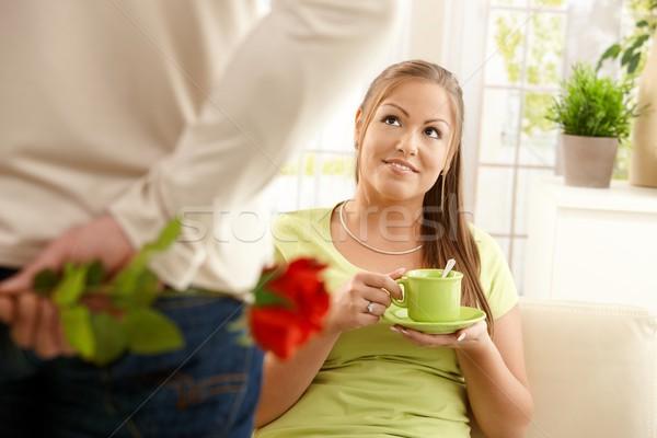 Man bringing flower to woman Stock photo © nyul