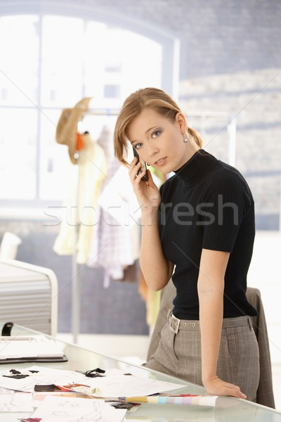 Stock photo: Young fashion designer talking on mobile