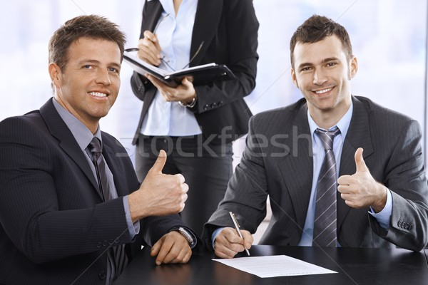 Businessmen giving the thumbs up, smiling Stock photo © nyul