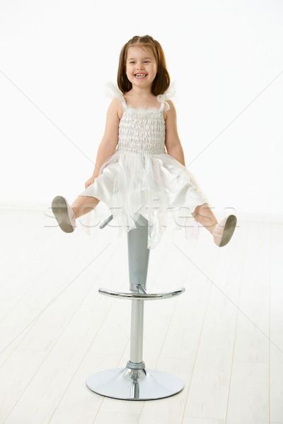 Happy little girl sitting on chair Stock photo © nyul