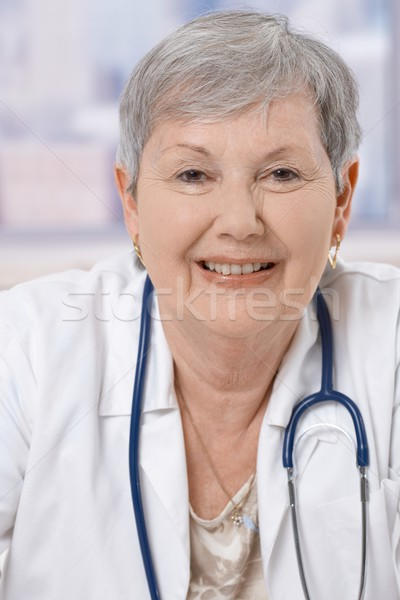 Stock photo: Portrait of happy senior doctor