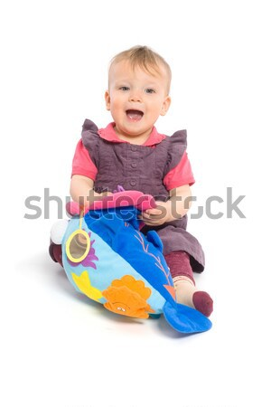Baby girl playing with toy - isolated Stock photo © nyul
