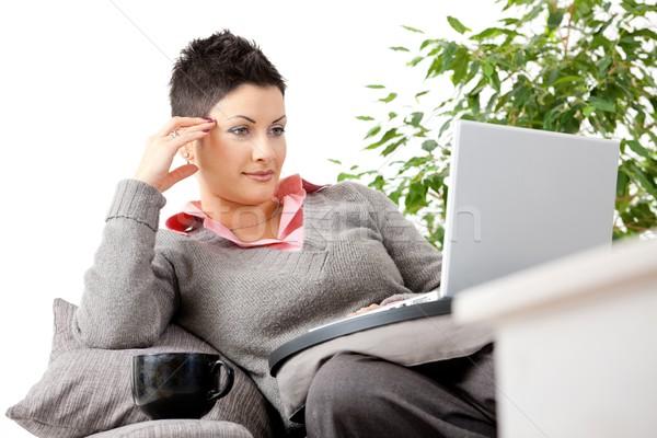 Nő otthon fiatal nő ül kanapé laptop számítógép Stock fotó © nyul