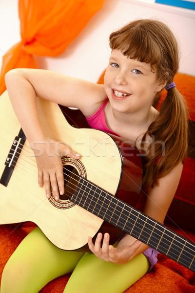 Aranyos iskolás lány gitár portré nevet kamera Stock fotó © nyul