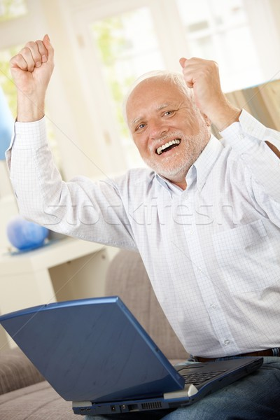 Old man celebrating with laptop Stock photo © nyul