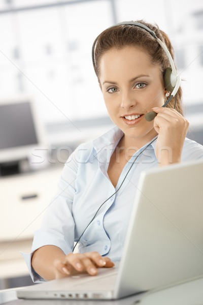 Pretty dispatcher working in office smiling Stock photo © nyul