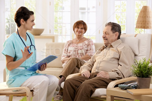 Nurse talking to elderly patients at home  Stock photo © nyul