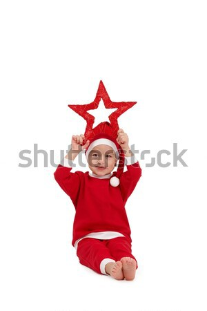 Little boy in santa wear with star Stock photo © nyul