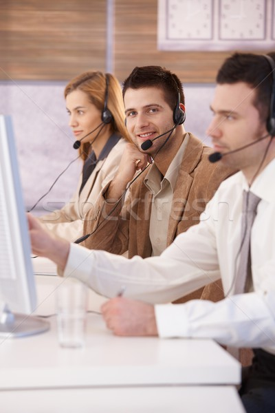 Happy dispatcher working in call center smiling Stock photo © nyul