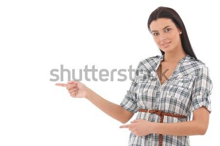 Stockfoto: Mooie · vrouw · wijzend · mooie · jonge · vrouw · permanente