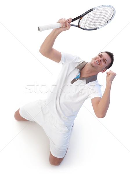 Stock photo: Happy tennis player celebrating victory