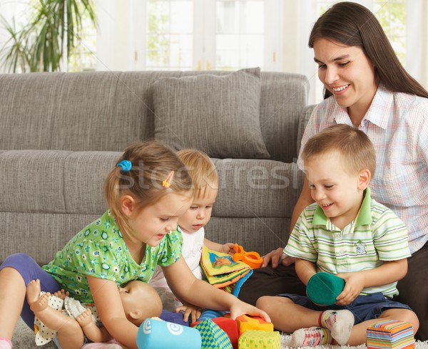 Mother playing with children at home Stock photo © nyul