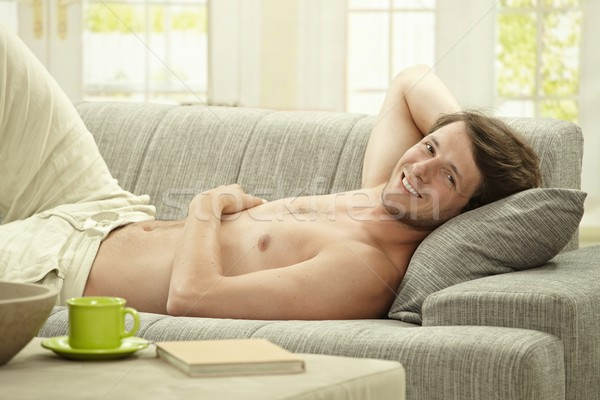 Young man resting at home Stock photo © nyul