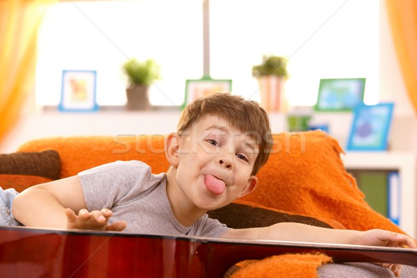 Five year old boy putting out tongue for pose Stock photo © nyul