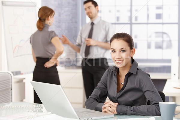 çekici işkadını gülen mutlulukla ofis oturma Stok fotoğraf © nyul