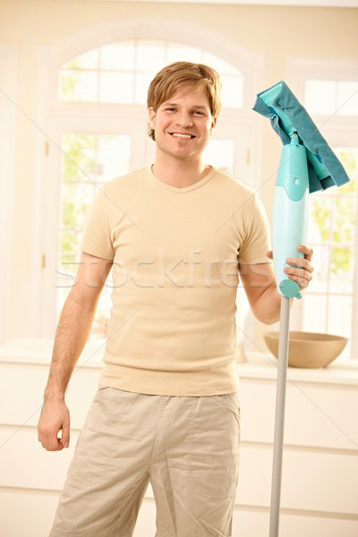 Guy posing with mop Stock photo © nyul