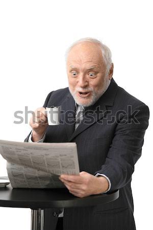 Meglepődött üzletember olvas újság portré idős Stock fotó © nyul