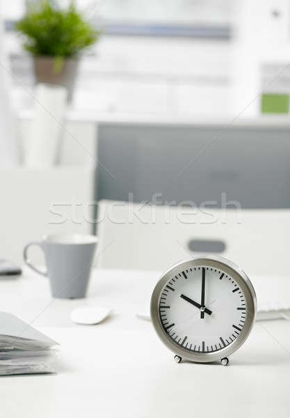 Clock on office desk Stock photo © nyul