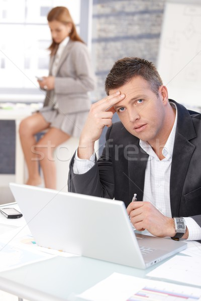 Middle-aged businessman sitting troubled at desk Stock photo © nyul