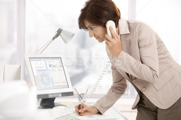Stock photo: Senior businesswoman at work