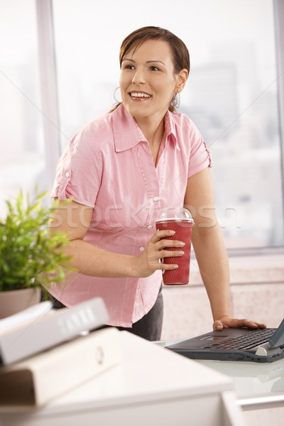 Office worker holding coffee to go Stock photo © nyul