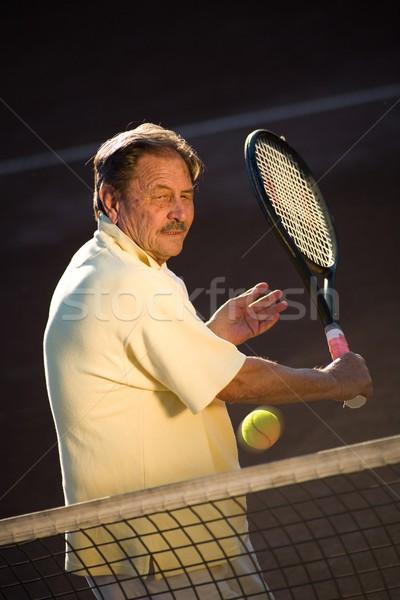 Senior man playing tennis Stock photo © nyul