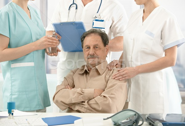 Old patient sitting on doctor's room Stock photo © nyul