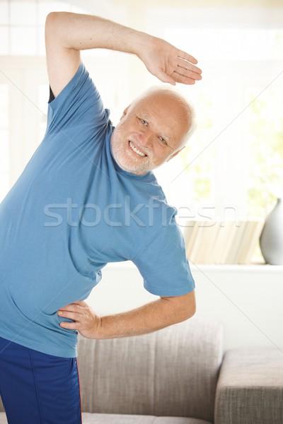 Cheerful senior doing sport Stock photo © nyul