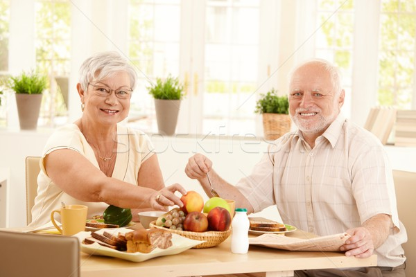 Elderly couple having breakfast Stock photo © nyul