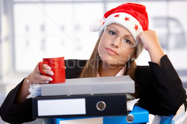 Young woman in santa hat exhausted in office Stock photo © nyul