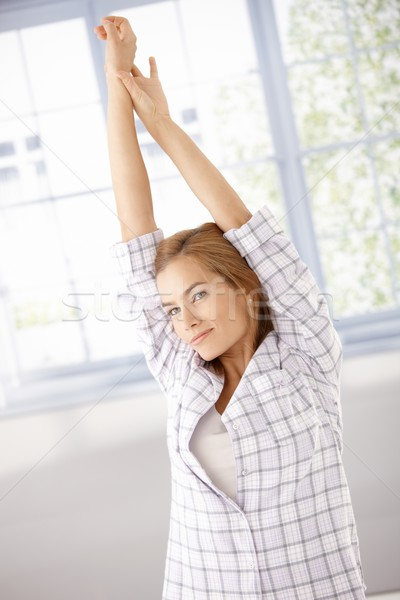 Young woman getting up stretching in the morning Stock photo © nyul