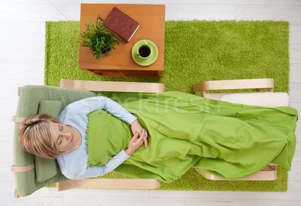 Сток-фото: женщину · спальный · кресло · покрытый · комнату