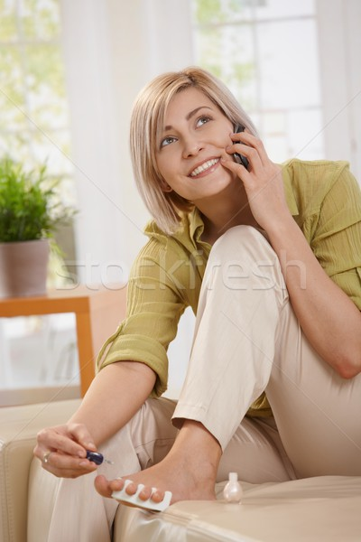 Woman polishing toe nails Stock photo © nyul