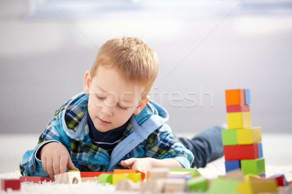 Lovely toddler playing with building cubes at home Stock photo © nyul