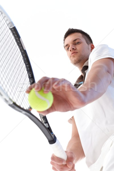 Young tennis player serving Stock photo © nyul
