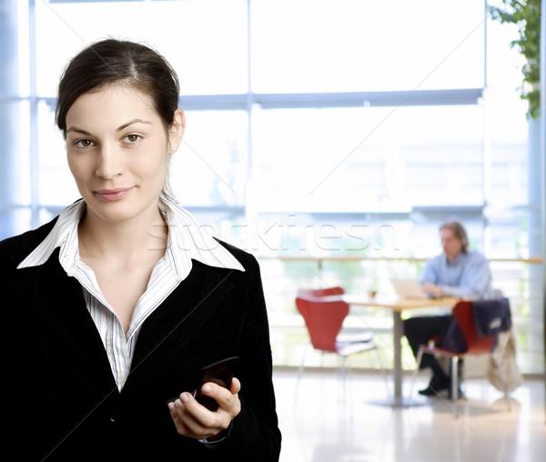 ストックフォト: 女性実業家 · 携帯電話 · 幸せ · 小さな · 笑みを浮かべて