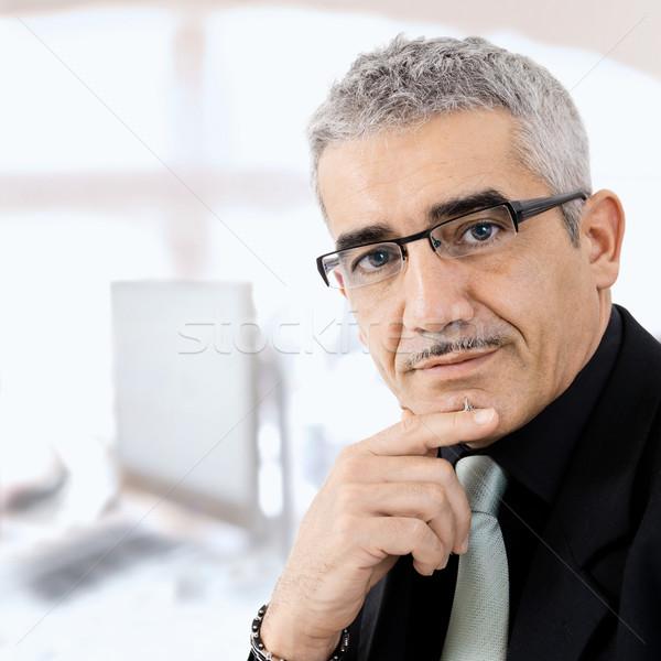 Maduro empresário pensando cinza criador olhando Foto stock © nyul