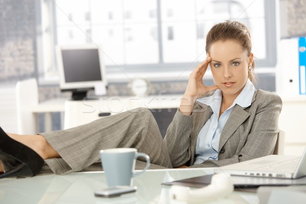 Young businesswoman sitting tired in office Stock photo © nyul