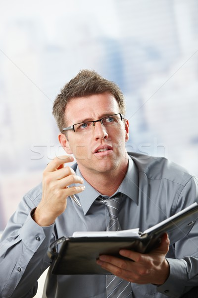 Businessman talking with organiser in hand Stock photo © nyul