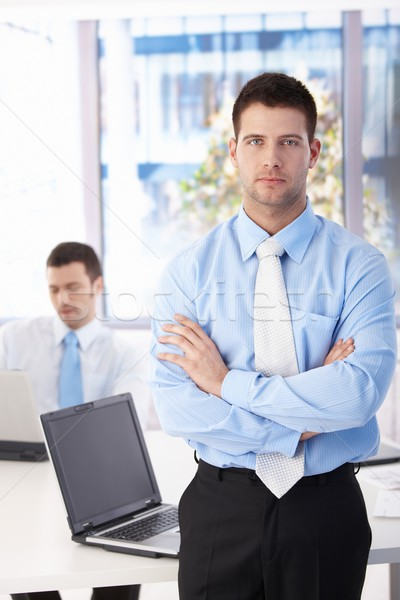 Confident businessman standing in bright office Stock photo © nyul