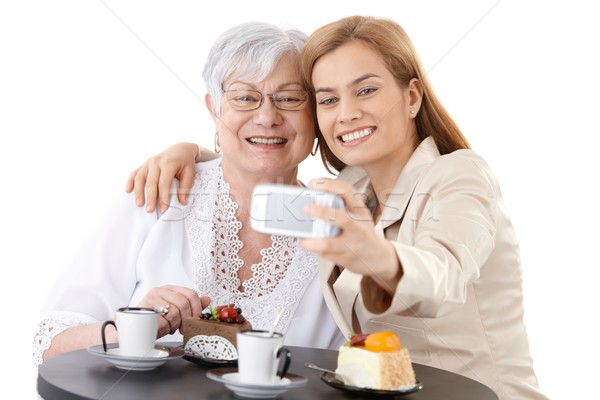 Mother and daughter photographing themselves Stock photo © nyul