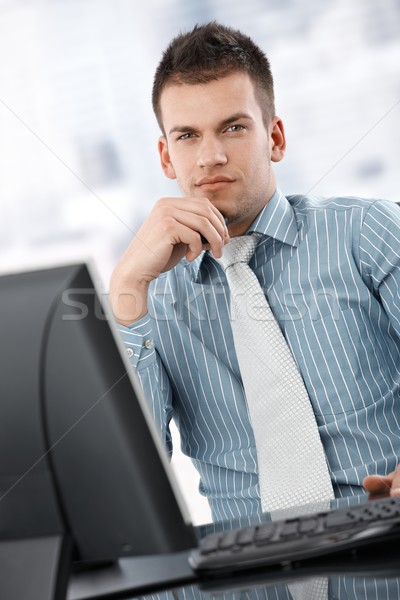 Serious businessman thinking at desk Stock photo © nyul