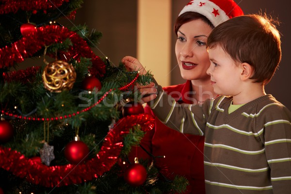 Stock photo: Mother and child with christmas tree