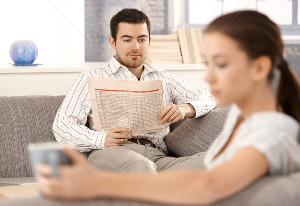 Young couple sitting separated in living room Stock photo © nyul