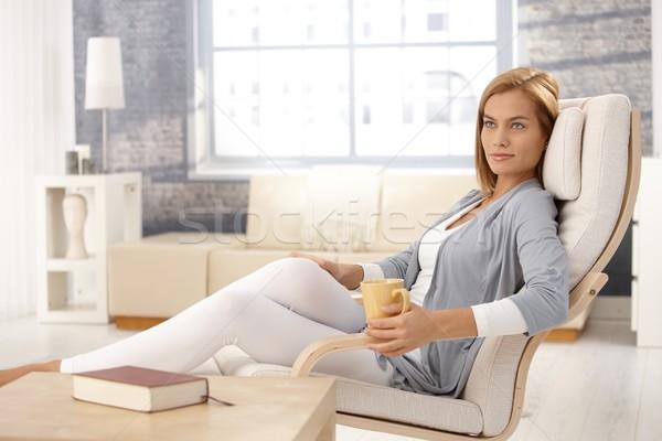 Mujer atractiva sillón taza de café retrato sesión relajante Foto stock © nyul