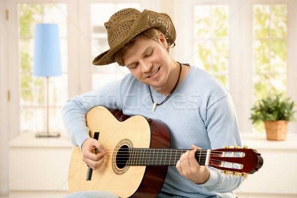 Stock photo: Man playing guitar