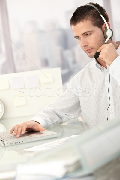 Young male dispatcher working in office Stock photo © nyul